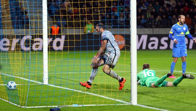 Roma's Vasilis Torosidis goes to pick up the ball after scoring his side's second goal during the the Champions League group E soccer match between Bate Borisov and Roma, in Borisov, Belarus, Tuesday, Sept. 29, 2015. (ANSA/AP Photo/Sergei Grits)